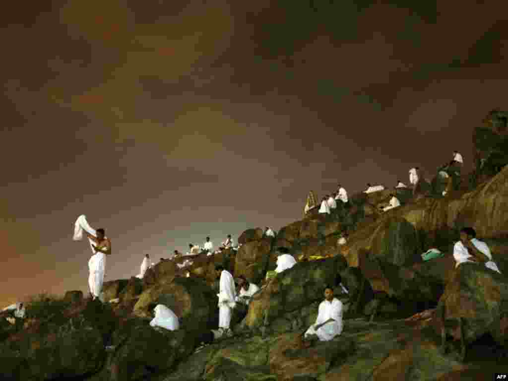 Muslim pilgrims gather at Mount Arafat, southeast of Mecca. - An estimated 2.5 million Muslims have gathered in Saudi Arabia to perform the hajj, the Islamic pilgrimage to the holy cities of Mecca and Medina. Photos by Mahmud Hams for AFP