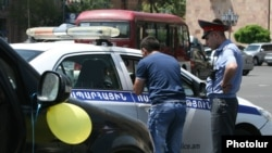 Armenia - A driver is fined by traffic police in Yerevan, 25May2012.