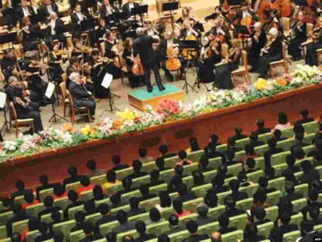 "The New York Philharmonic orchestra performs in North Korea - Members of the North Korean audience listen to the New York Philharmonic orchestra led by Musical Director (conductor) Lorin Maazel during their inaugural performance in the North Korea capital, Pyongyang on February 26, 2008. The concert represents an unprecedented cultural exchange between North Korea and the United States, which labeled Pyongyang part of the ""Axis of Evil"" along with Iran and Iraq, prior to the US-led 2003 war."