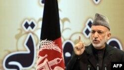 President Hamid Karzai speaks during the opening of the Loya Jirga, in Kabul on November 21, 2013.