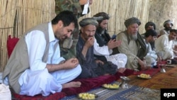 Asadullah Khalid (left) meets with journalists and local elders during his time as governor of Kandahar Province in 2008.