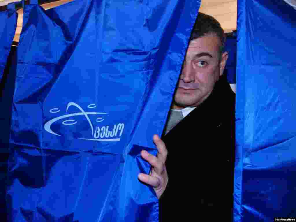 Unified opposition candidate Levan Gachechiladze exits a polling booth in Tbilisi on election day. Gachechiladze, who is considered the strongest challenger to Saakashvili, has said that if elected he will abolish the presidency and form a parliamentary republic.