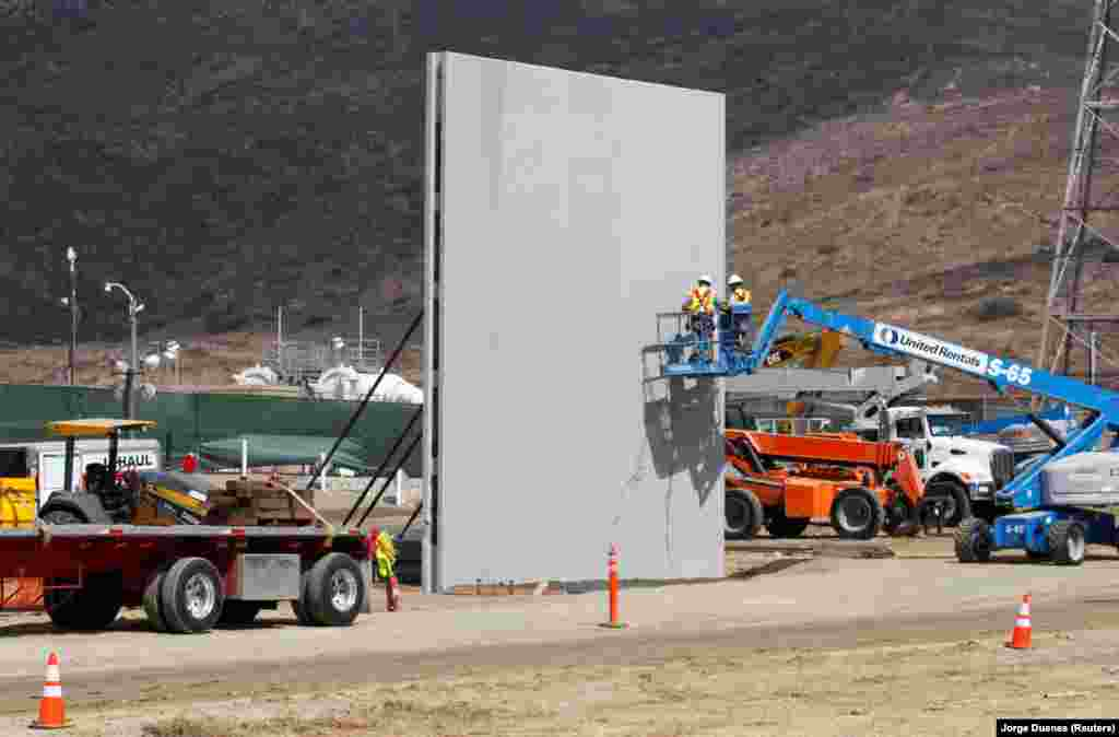 A photograph taken from the Mexican side of the border in Tijuana shows a construction site in San Diego, California, for prototypes of U.S. President Donald Trump's long-discussed border wall, which has yet to be funded by Congress. (Reuters/Jorge Duenes)