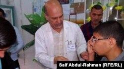 Iraq – at an oculist, Kut, 12Aug2013
