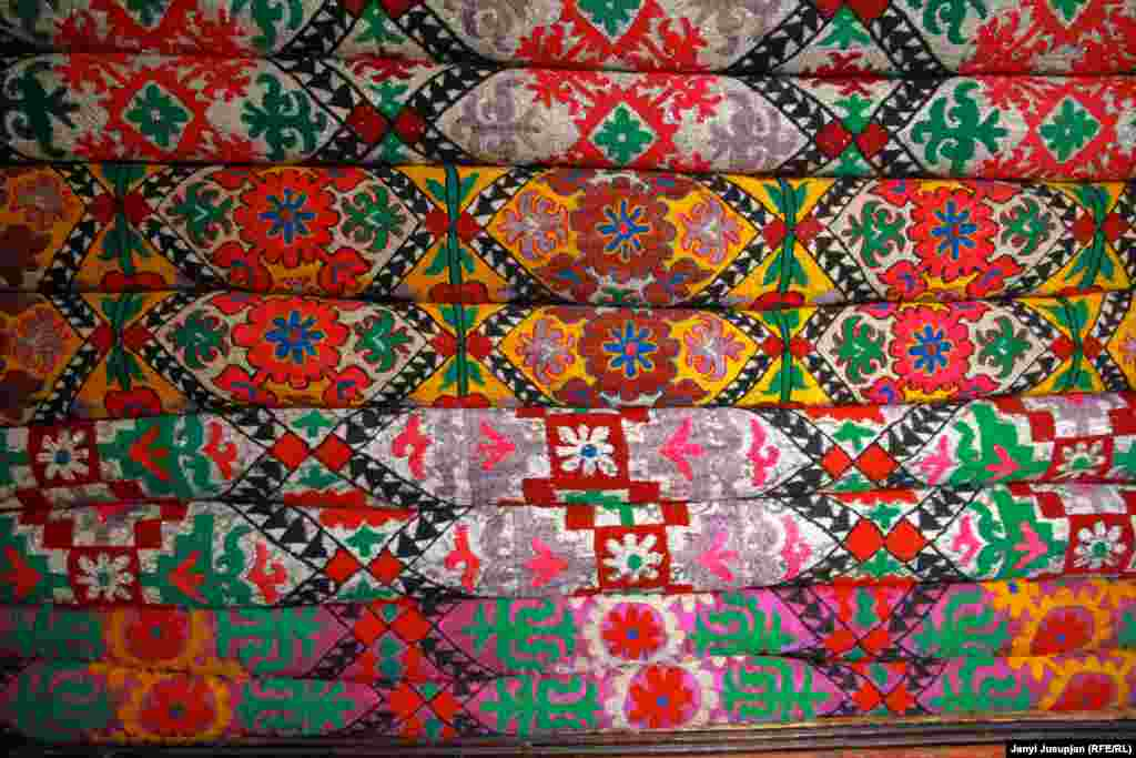 Bed covers embroidered by Avaz's wife, Dilbarkan. The handiwork of women in Jerge-Tal is exceptional, but Dilbarkan's daughters are not interested in learning this heritage of their ancestors.