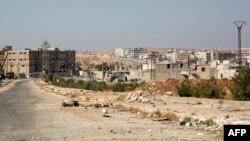 Damaged roads and abandoned buildings in Aleppo's rebel-held Kalasa neighborhood following months of air strikes.