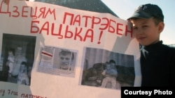 Syarhey Kavalenka's son pickets in Vitebsk in May 2012 for his father's freedom.