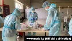 Medical workers in a temporary hospital set up in Bishkek to handle the large number of coronavirus cases