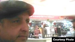 Абдрэшид Кушаев, беженец из Узбекистана в магазине в эстонском Тарту. Фото в Facebook'e.