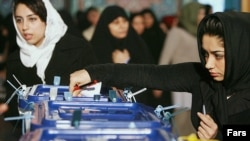 Iran -- An Iranian girl casts her vote in tenth presidential election on 11Jun2009.