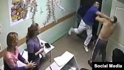 A screengrab from a video posted on line appears to show Russian Doctor Ilya Zelendinov striking a patient. Prosecutors believe the incident caused a severe brain injury that killed the patient.