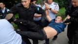 KAZAKHSTAN -- Kazakh police detain a demonstrator during protests against presidential elections, in Almaty, June 10, 2019