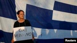 Žena sa transparentom 'Ne'