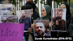 Demonstrators hold portraits of Zelimkhan Khangoshvili in front of the German Embassy in Tbilisi in September.