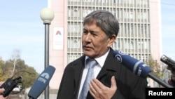 Almazbek Atambaev, who is set to become the next president of Kyrgyzstan, talks to journalists in Bishkek on October 31.