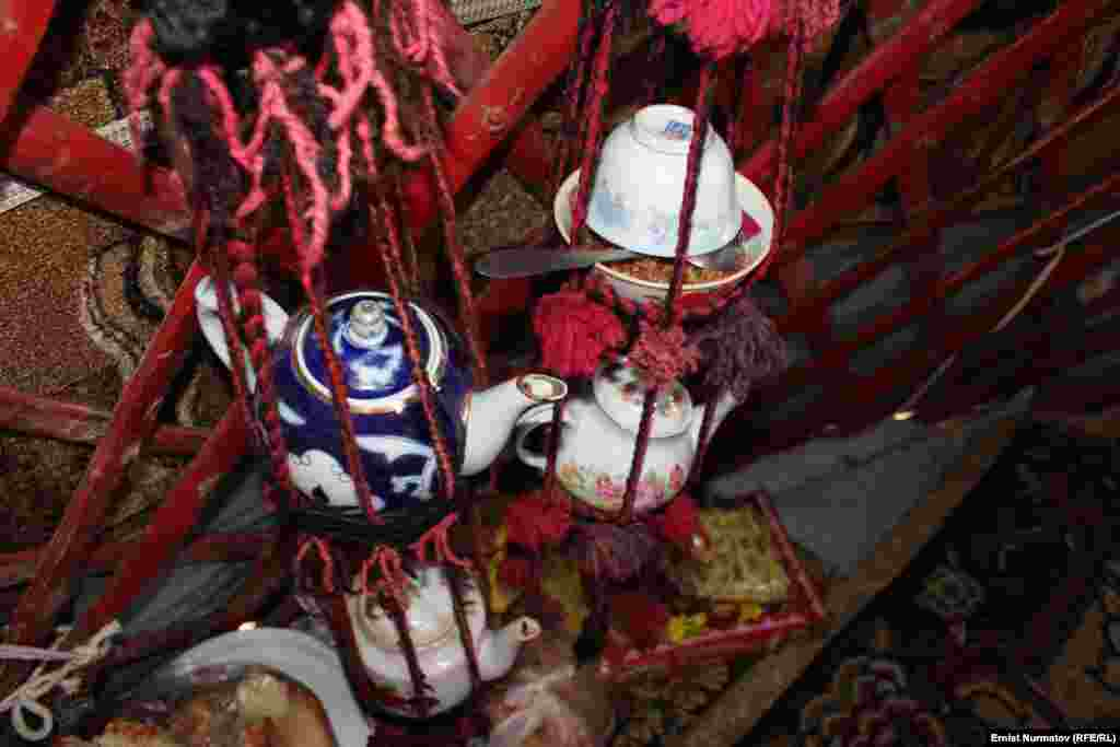 Dishes, teapots, and other items are kept suspended inside the yurt.