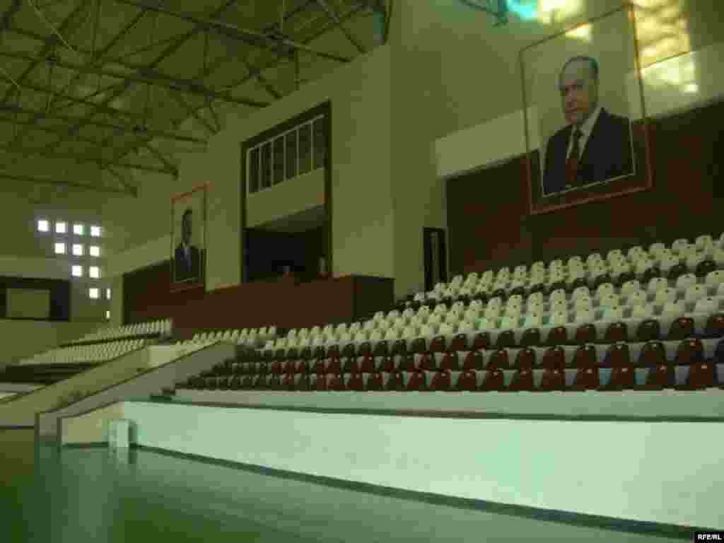 Portraits of President Ilham Aliyev, who previously headed Azerbaijan's Olympic Committee, and his late father, Heidar Aliyev, watch over an empty gym - The swimming pool at the Masalli sports center remains dry -- and locals say the complex has just one regular visitor. Meanwhile, its upkeep and maintenance cost some $10,000 each month.
