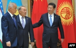 Septuagenarian Presidents Islam Karimov (left) of Uzbekistan and Nursultan Nazarbaev of Kazakhstan (center) walk with Chinese President Xi Jinping at a summit of the Shanghai Cooperation Organization in Bishkek in September 2013.