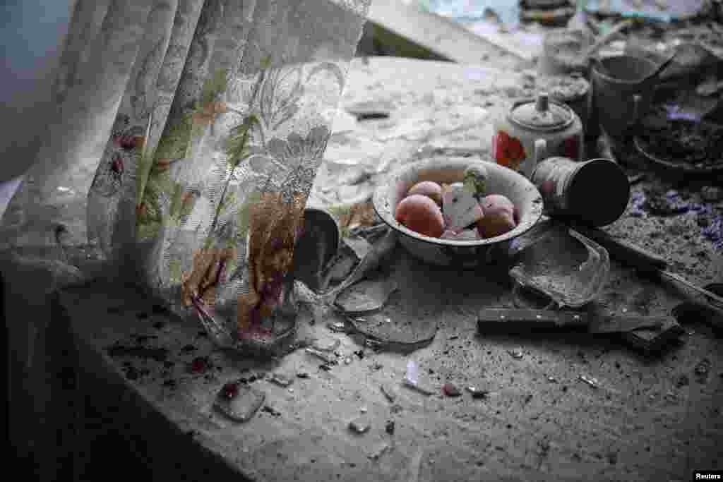 Sergei Ilnitsky, a Russian photographer of the European Pressphoto Agency, won First Prize in the General News Category, Singles, for this image of damaged goods lying in a kitchen in downtown Donetsk, in war-torn eastern Ukraine.