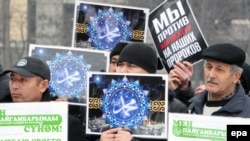 "Kyrgyz Muslims hold banners saying ""We love Muhammad"" during a rally against the French magazine Charlie Hebdo's satirical cartoons of the Prophet Muhammad in Bishkek on January 20."