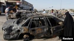 Бағдадтың Хуррия ауданында бұған дейін болған жарылыстардың бірінен кейінгі көрініс, Ирак.