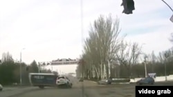 Video of the accident shows that traffic lights had been red for more than five seconds before a Russian diplomat's car plowed into another vehicle at a Bishkek junction.