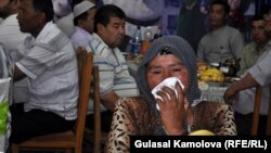 An Osh woman who lost her grandchild, son, and daughter during ethnic violence in June 2010 mourns at the commemoration ceremony on June 10.