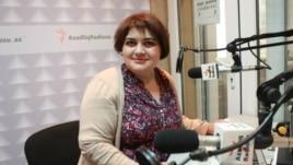 Female reporter sitting in radio studio