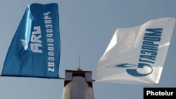 Armenia -- The flags of the ARG national gas operator and its dominant Russian shareholder, Gazprom.