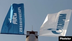 Armenia -- The flags of the ARG national gas operator and its dominant Russian shareholder, Gazprom, undated.