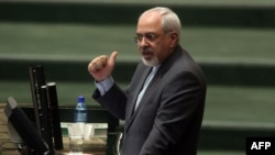 Foreign Minister Mohammad Javad Zarif addresses the parliament in Tehran on November 27.