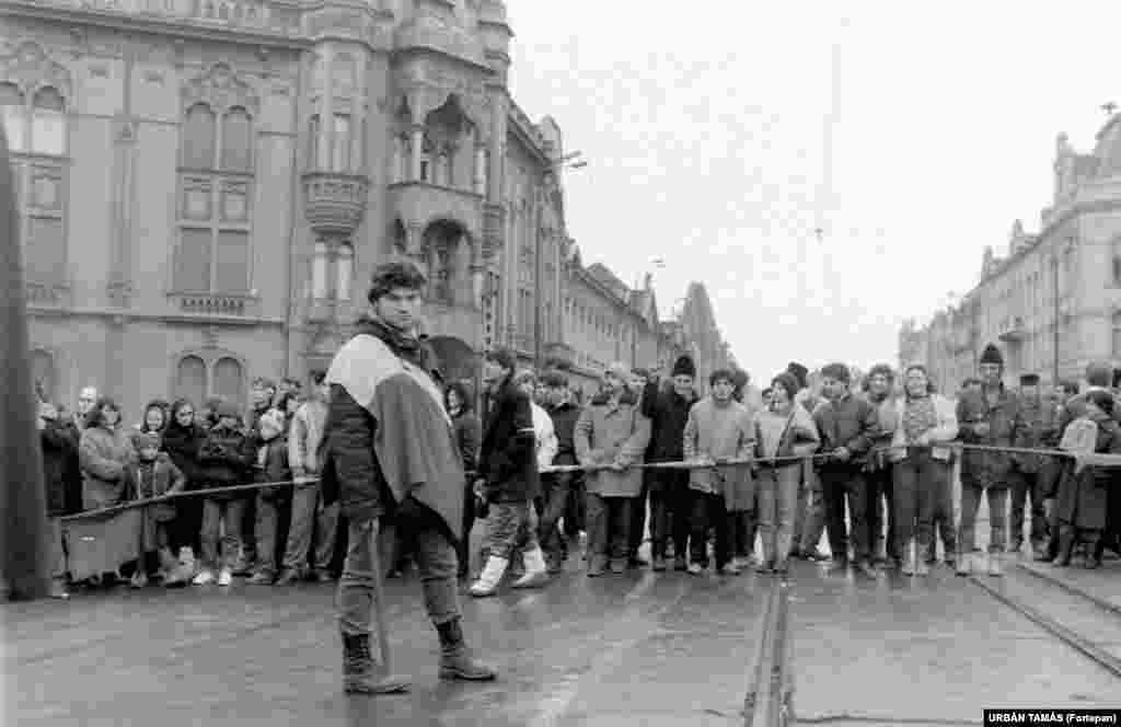 Locals block a road in the western city of Timisoara on December 16, 1989, during the beginning of what would become known as the Romanian Revolution.
