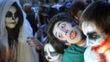 Kyrgyzstan -- Students dressed as zombies participate in an annual Halloween party in central Bishkek, October 31, 2013