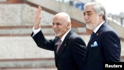 The Afghan government is itself divided along ethno-linguistic lines, with President Ashraf Ghani (left) and Chief Executive Abdullah Abdullah -- who draw support from the Pashtun and ethnic Tajik communities, respectively -- uneasily sharing power.
