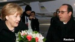 Ангела Меркель и Франсуа Олланд в аэропорту Минска. 11 февраля