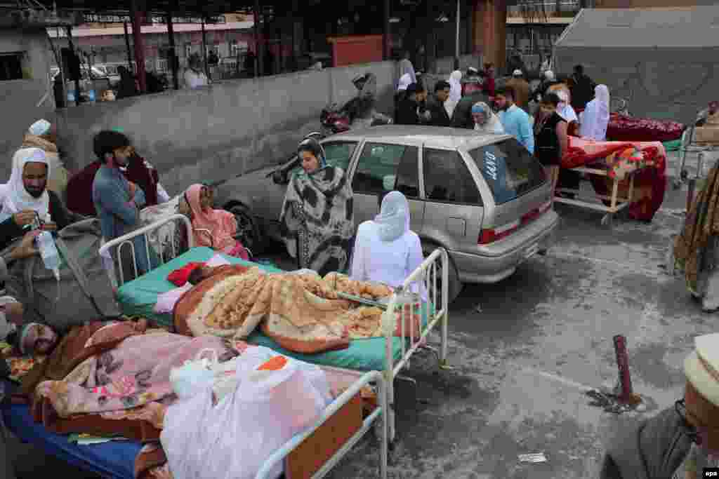 People injured in the earthquake receive medical treatment outside a hospital in Abbottabad, Pakistan.