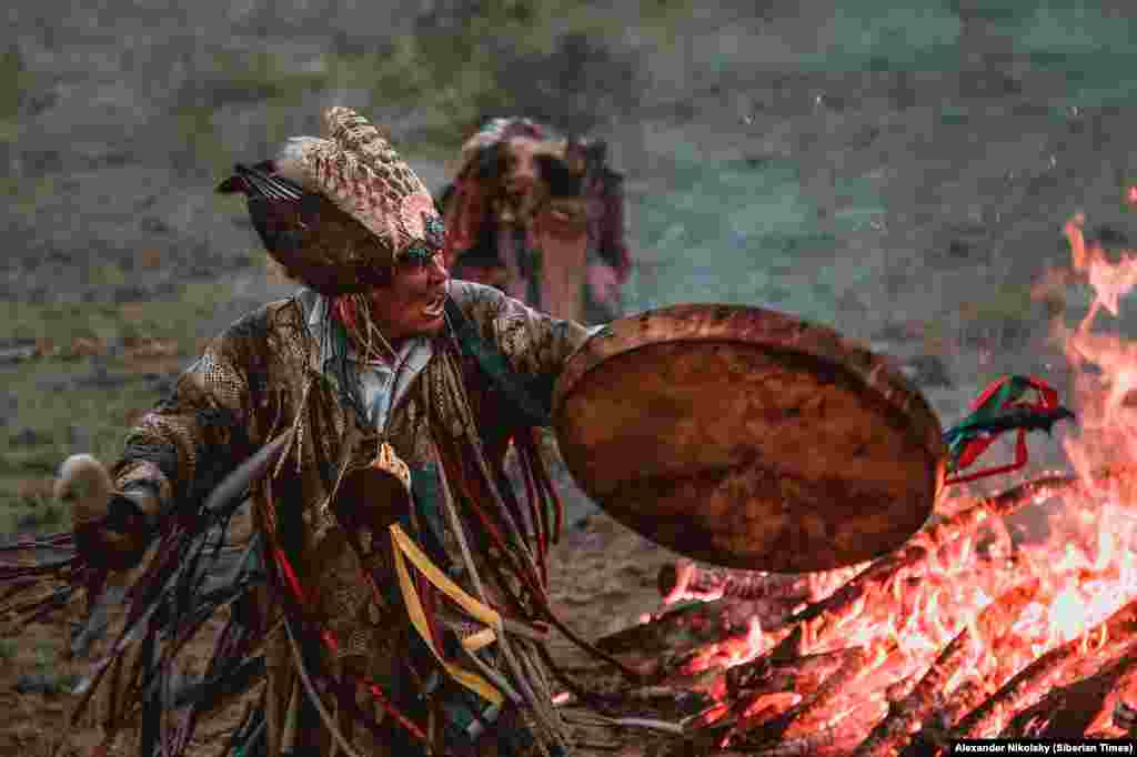 A shaman hammers his drum during a ritual in Russia's Tuva Republic, in southern Siberia. During ceremonies like this, the beat of the drum grows steadily faster as the shamans circle a fire. While the beat intensifies, unearthly screams come from the shaman. At the height of the ritual the soul of the shaman is said to leave his or her body in order to make room for a spirit to enter.