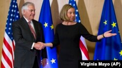 U.S. Secretary of State Rex Tillerson (left) meets with EU foreign policy chief Federica Mogherini in Brussels on December 5.