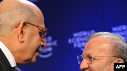 El-Baradei (left), with Iranian Foreign Minister Manuchehr Mottaki in Davos in late January, says Tehran has stopped cooperating in recent months
