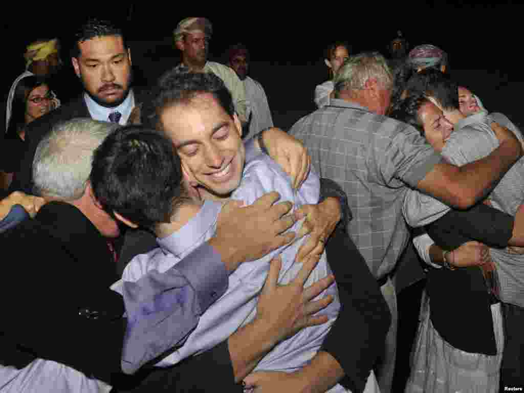 U.S. citizens Josh Fattal and Shane Bauer, who were held in Iran on charges of espionage, are greeted by their families upon arriving in Oman after being released on $1 million bail. (Photo taken by Sultan Al Hasani for Reuters)