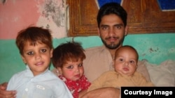 Rasool Dawar with his children.