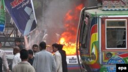 More than 15 people were killed in this suicide bomb blast targeting a Shi'ite Ashura procession in Karachi in 2009. Lashkar-e Jhangvi and its splinter groups have killed thousands in Pakistan.