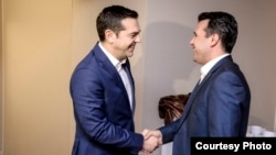 Macedonian Prime Minister Zoran Zaev (right) met his Greek counterpart Alexis Tsipras on the sidelines of the World Economic Forum in Davos on January 24.