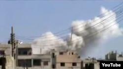 نمایی از بمباران شهر حمص در سوریه از سوی نیروهای بشار اسد.
