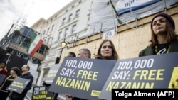U.K. -- Campaigners hold posters as Richard Ratcliffe, husband of jailed British-Iranian woman Nazanin Zaghari-Ratcliffe, delivers a petition and a letter addressed to the Iranian Deputy Foreign Minister Abbas Araghchi to demand her release, at the Irania