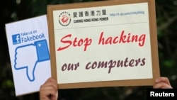 "China -- A demonstrator from the pro-China ""Caring Hong Kong Power"" group protests over claims from former U.S. spy agency contractor Edward Snowden that NSA hacked computers in China, outside the U.S. Consulate in Hong Kong July 9, 2013."