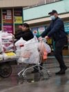 A man carries food in the Central market area in Almaty. March 18, 2020