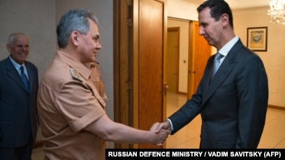 Russia Defense Minister Meets With Syria's Assad, Hands Him