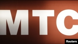 Russia -- A board displays the logo of Russian mobile phone operator MTS is seen in Moscow, 25Feb2012