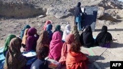Schoolgirls study at an outdoor classroom in the rural district of Laghman Province in November 2012. (file photo)